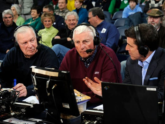 FILE -- ESPN game commentators from left, Digger Phelps, Bob Knight and Rece Davis talk during a game between Notre Dame and St. John's, March 5, 2013 in South Bend, Ind.