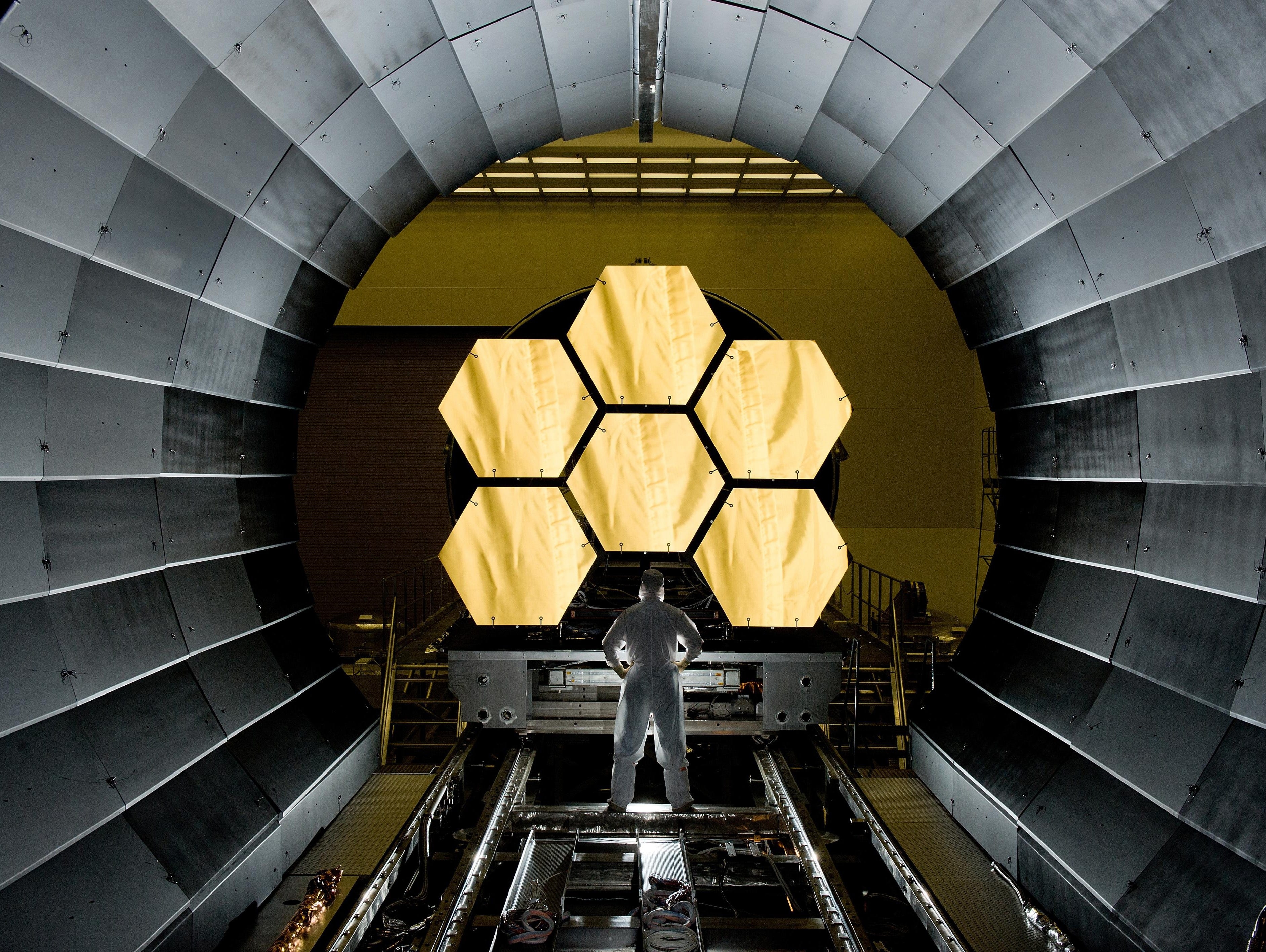 NASA engineer Ernie Wright check out the first six completed segments of the primary mirror for the James Webb Space Telescope, the successor to Hubble.