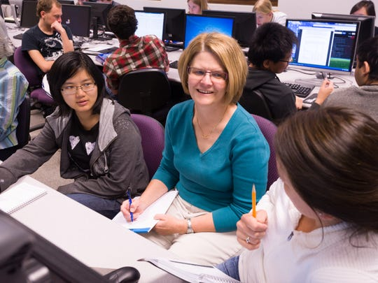 Colorado State University Statistics Professor Jennifer Hoeting works with students in her class.