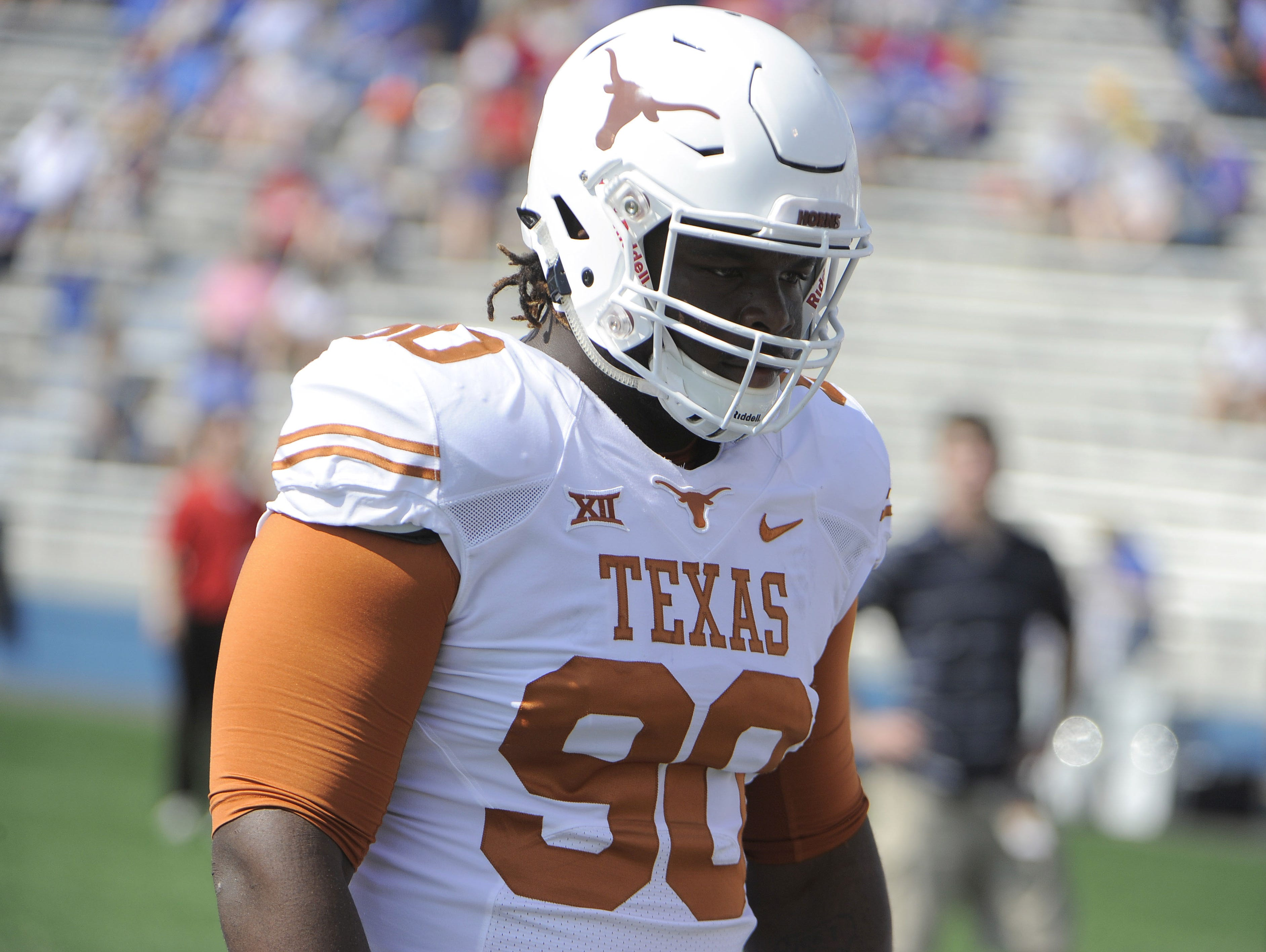 Sep 27, 2014; Lawrence, KS, USA; Texas Longhorns defensive tackle Malcom Brown (90) warms up before the game against the Kansas Jayhawks at Memorial Stadium. Texas won the game 23-0. Mandatory Credit: John Rieger-USA TODAY Sports