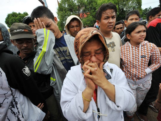 Sept. 30, 2009: 1,100 dead in Indonesia. Family members