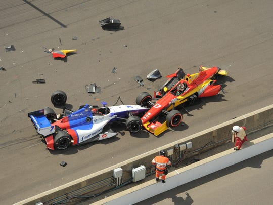 Mikhail Aleshin and pole  sitter, Sebastian Saavedra  crash at the start of the 2014 Grand Prix of Indianapolis.