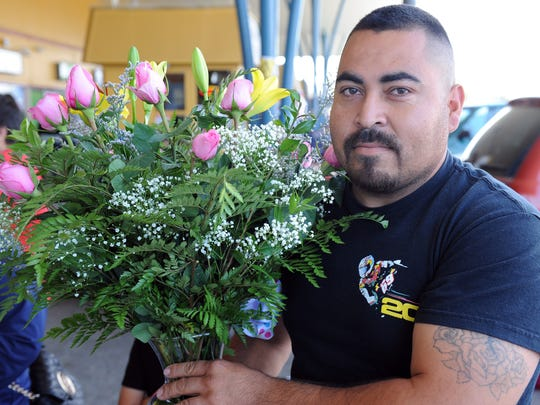 At the Alisal shopping center on Sunday, Jose Martinez of Salinas picked out a beautiful arrangement to celebrate Mother's Day.