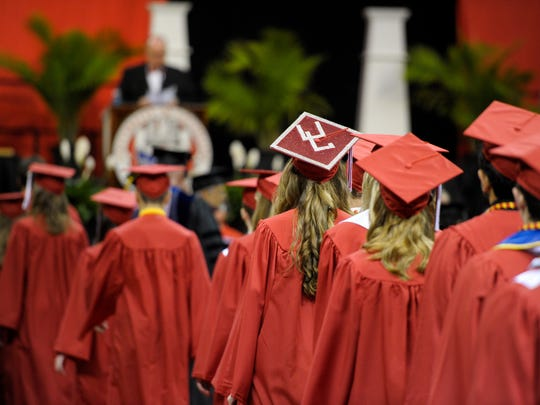 UL graduates sport customized mortarboards during the university's spring commencement general assembly at the Cajundome in Lafayette, LA, Friday, May 15, 2015.