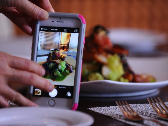 No DSLR? No problem. Many dining spots have dim lighting. Steady your phone camera by setting it on the table. Choose your focal point and adjust your exposure.