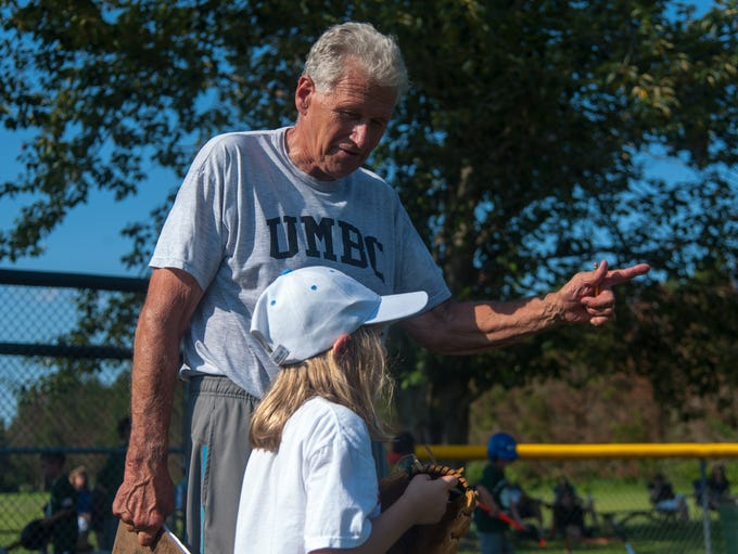 Tom Brown helps instruct one of his young athletes