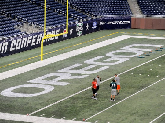"""""""Oregon"""" is painted in Ford Field's end zone on Tuesday"""