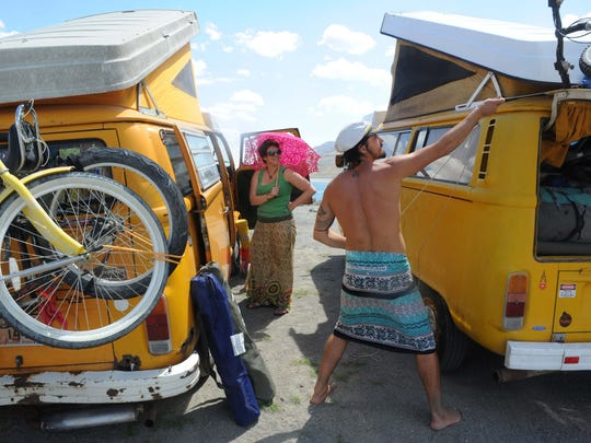 Waiting to get into Burning Man 2014: By pure coincidence, Janelle Coburn of Portland, Ore., and Otto, of Israel, ending up parking side by side with identical VW vans. They had never met.