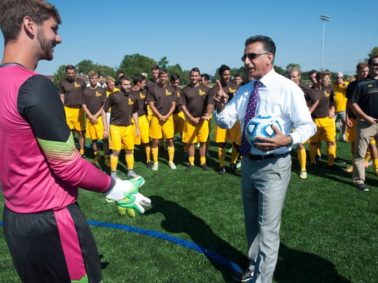 Rowan University President Dr. Ali A. Houshmand prepares to take a shot on goal as Rowan opens its newest practice fields on its west campus. Wednesday, August 26, 2015