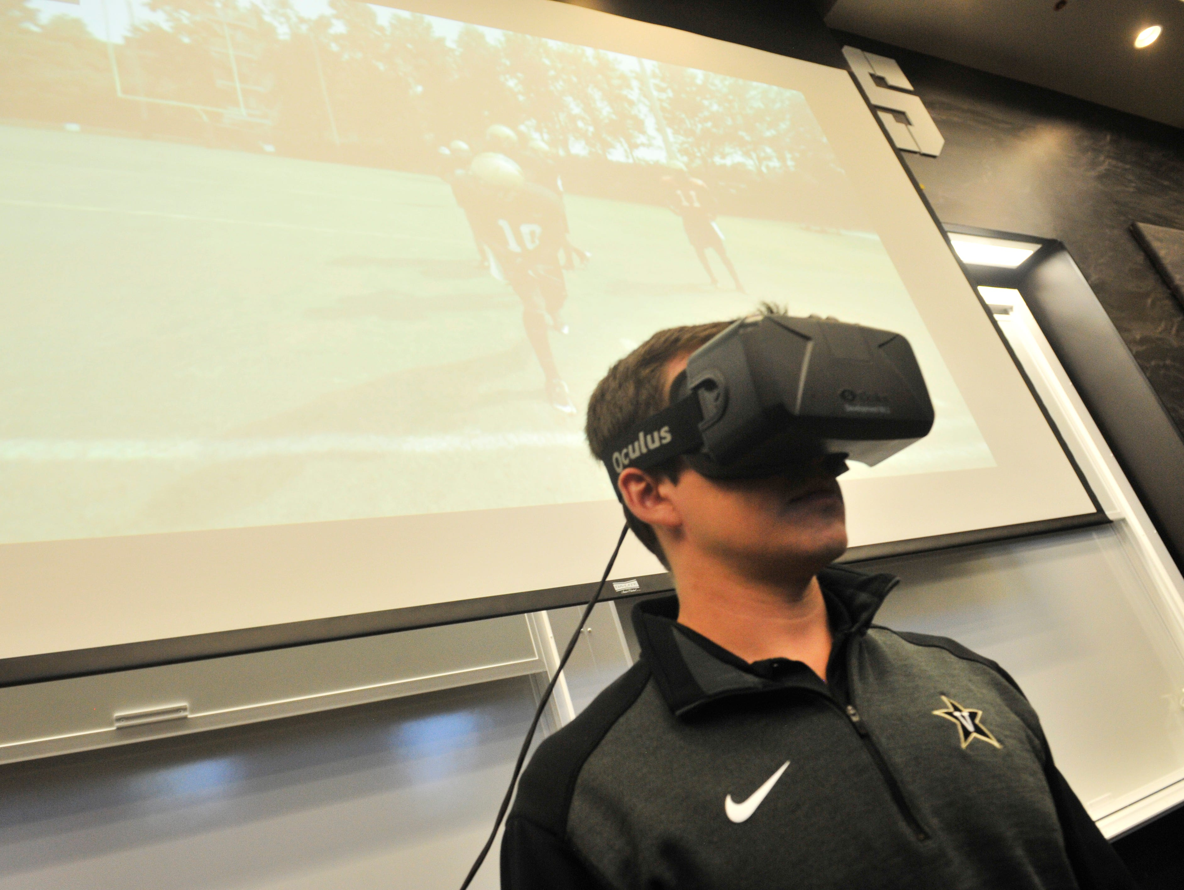 Vandy's Assistant Director of Video Productions Josh Pohl demonstrates the use of virtual reality gear in the Vanderbilt team meeting room in the McGugin Center on the Vanderbilt University campus in Nashville, August 28, 2015.