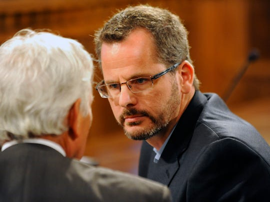 State Rep. Todd Courser talks with attorney Daniel