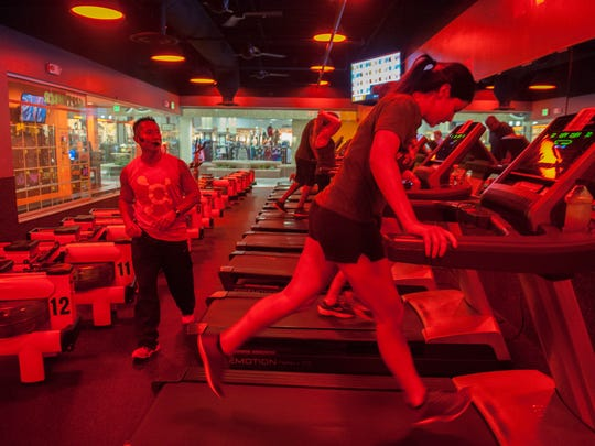 Head trainer James Lam leads a class at Orangetheory Fitness in Moorestown. Backed by the science of post-exercise oxygen consumption (EPOC), Orangetheory Fitness' heart-rate monitored training is designed to keep heart rates in a target zone that spikes metabolism and increases energy. Thursday, September 11, 2015.