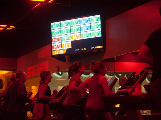 Client's heart rates are monitored and displayed on a screen during a program at Orangetheory Fitness in Moorestown. Backed by the science of post-exercise oxygen consumption (EPOC), Orangetheory Fitness' heart-rate monitored training is designed to keep heart rates in a target zone that spikes metabolism and increases energy. Thursday, September 11, 2015.