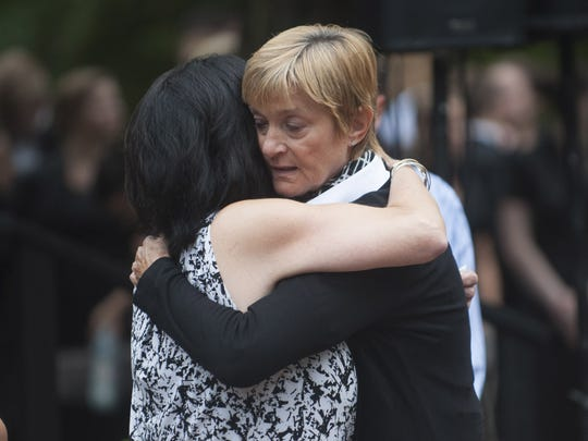Nancy Brandemarti and Joyce Rodak embrace following the Patriot Day memorial ceremony at Chestnut Branch Park's Place of Reflection in Mantua Twp. Friday, September 11, 2015.
