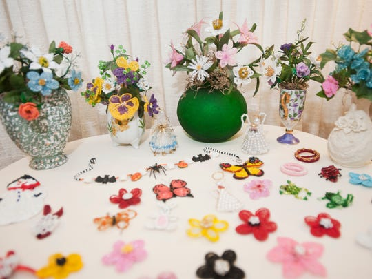 In this file photo, Velma Cox has a display table to show the bead crafts she has made. Cox has made about 30 French bead flower bouquets and many other bead items during the past six years.