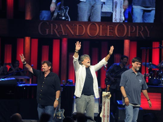 Jeff Cook, Randy Owen and Teddy Gentry wave to the