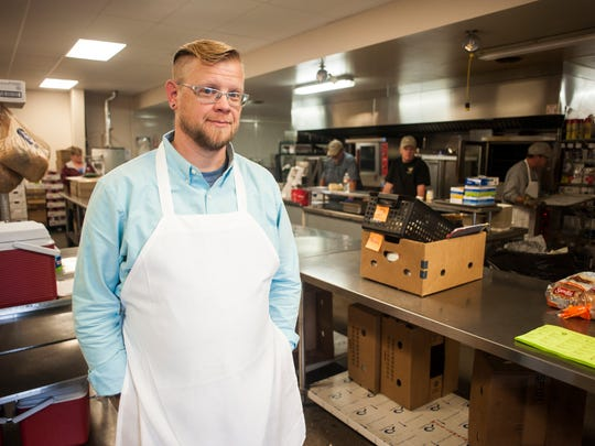 Christopher Sizemore, senior nutrition program manager for Meals on Wheels, poses for a portrait in the kitchen Thursday, Sept. 24, 2015.