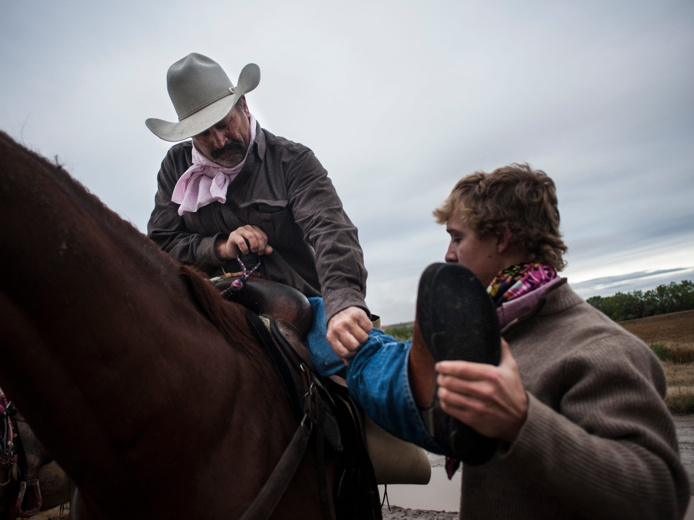 Though Toren needs his son, Brandon, to help him mount his horse, he can dismount on his own. Toren prefers to use leg braces that lock at the knee rather than a wheelchair because they provide better mobility on rough or muddy terrain.