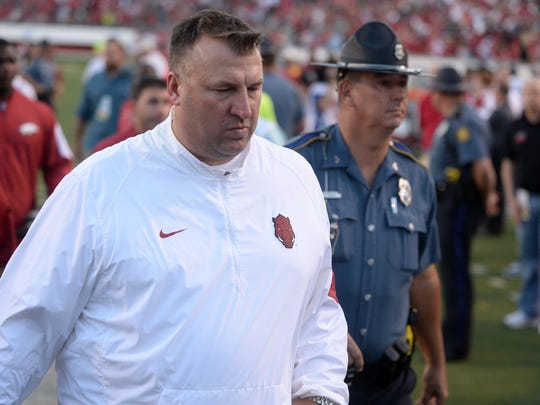 Arkansas coach Bret Bielema leaves the field after his team was upset by Toledo on Sept. 12.