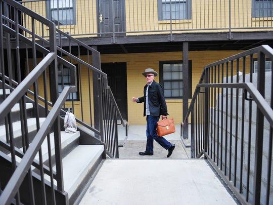 Jack Cawthon, owner of Jack's Bar-B-Que, walks through