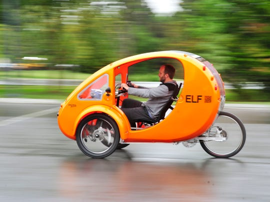 Joel Griffith rides in an ELF (the name stands for Electric, Light and Fun) in Centennial Park in Nashville. Griffith is helping to get an ELF dealership in the area.