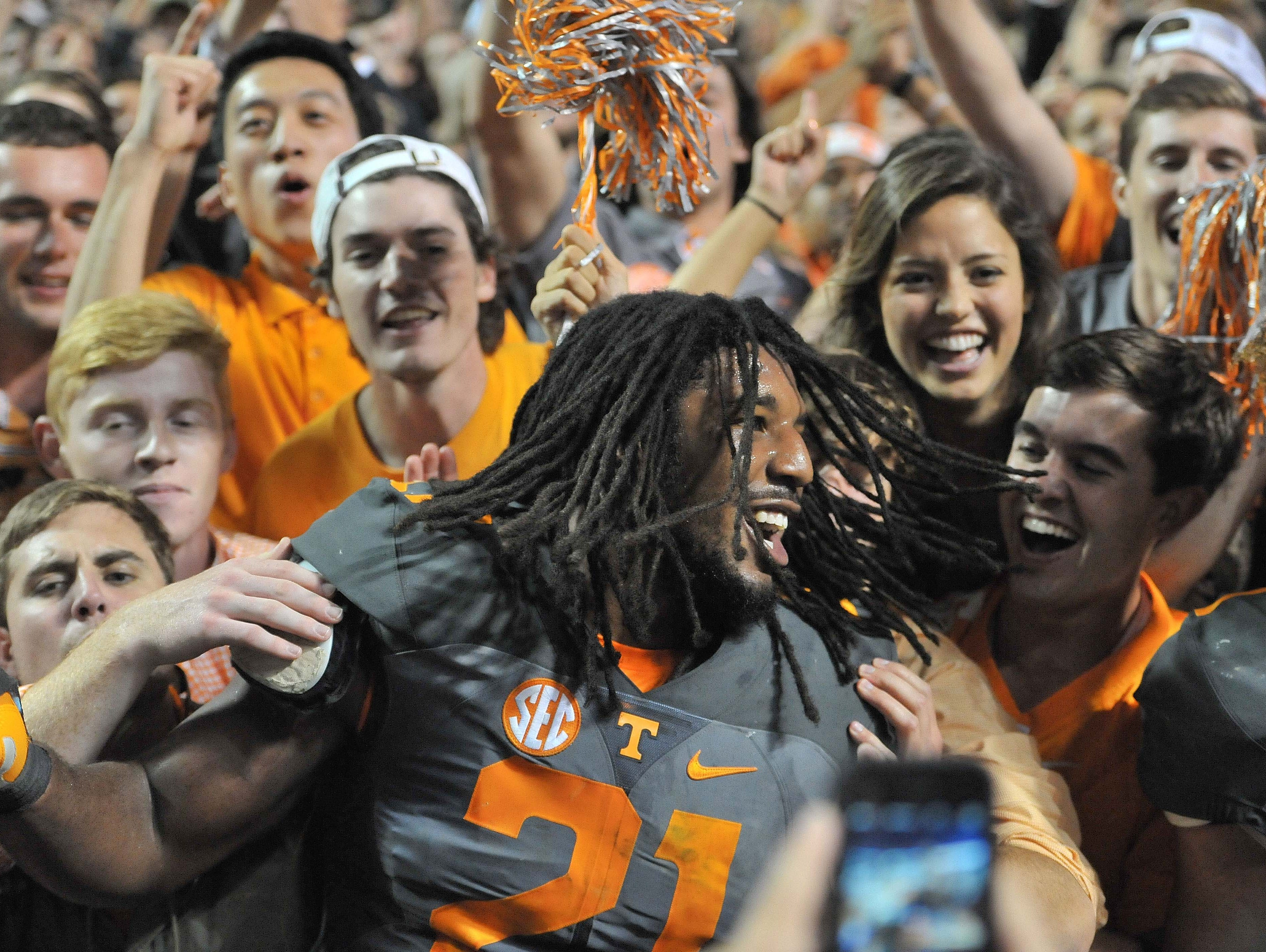 Oct 10, 2015; Knoxville, TN, USA; Tennessee Volunteers linebacker Jalen Reeves-Maybin (21) celebrates with fans after defeating the Georgia Bulldogs during the second half at Neyland Stadium. Tennessee won 38-31.