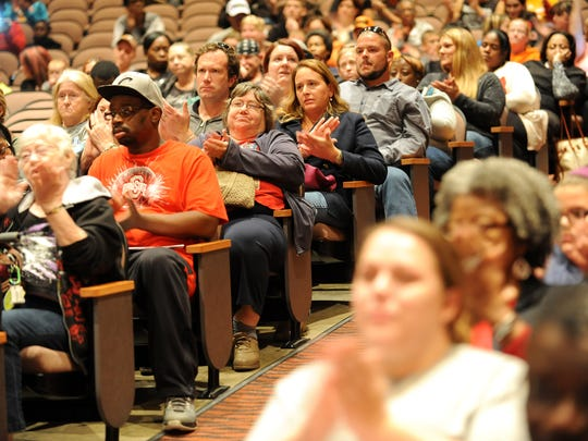 Concerned members of the community applaud during a public forum Thursday evening at Mansfield Senior to discuss concerns surrounding the recent threats.