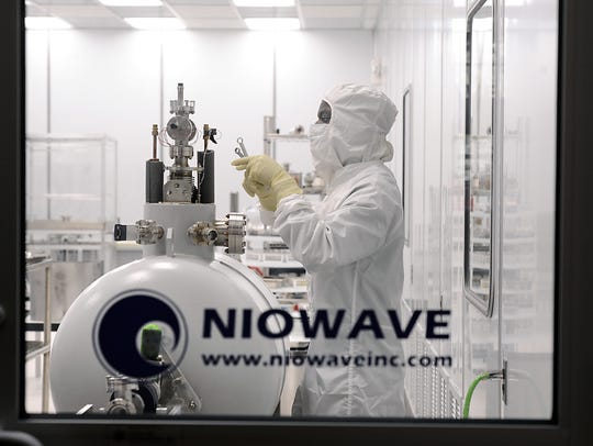 Niowave accelerator technician Ryan Brown works in
