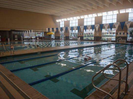 Club members swim in the indoor pool facilities at