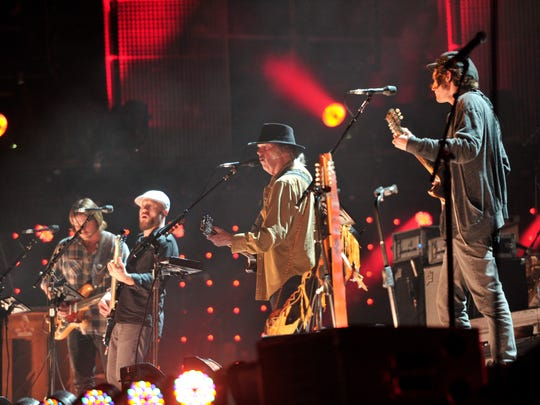 Neil Young performs at Farm Aid 30 with Lukas Nelson & Promise of the Real earlier this year.
