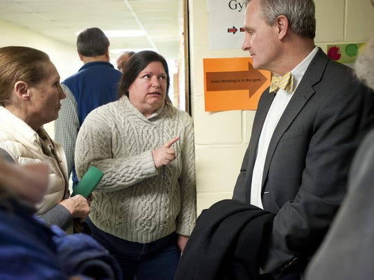 Maren Vasatka (center) talks with Sen. Chris Bray (D-Addison) about the proposed Vermont Gas Systems natural gas pipeline outside of Monkton's town meeting on Tuesday March 4, 2014.
