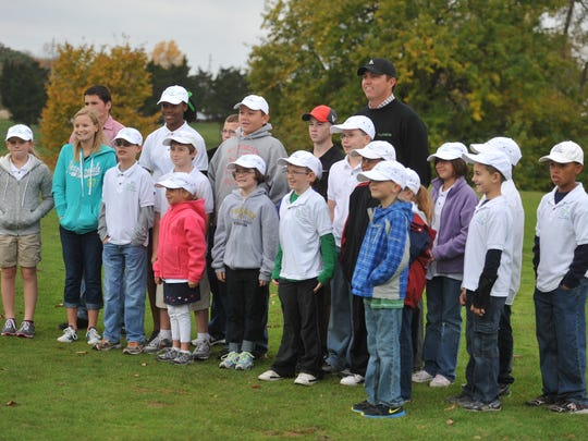 Bo Van Pelt poses for a photograph with First Tee participants