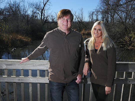 "Todd Magnuson and Terri Lawrenz of the show ""Nature Adventures"" explore the scenery at the Outdoor Campus in Sioux Falls."