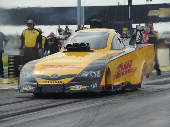 Del Worsham' Funny Car leave the starting line during the NHRA US Nationals at Lucas Oil Raceway, Monday, Sept. 1 , 2014.