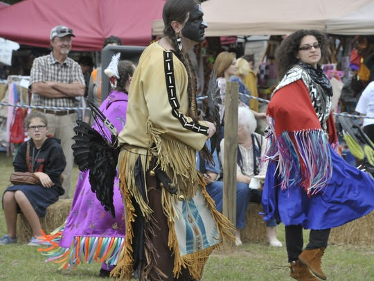 Creek Indian Tribe members participate in an inter-tribal dance Saturday at the 25th Annual Santa Rosa County Creek Indian Tribe Pow Wow at Floridatown Park, in Milton.