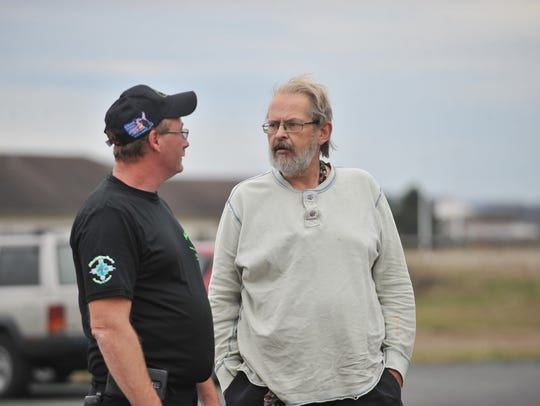 William Allman, left talks to Bob Comyack Nov. 17, 2015 on the day Allman's Complete Auto & Truck Center gave Comyack, a veteran, a car to replace his old one for Veterans Day.