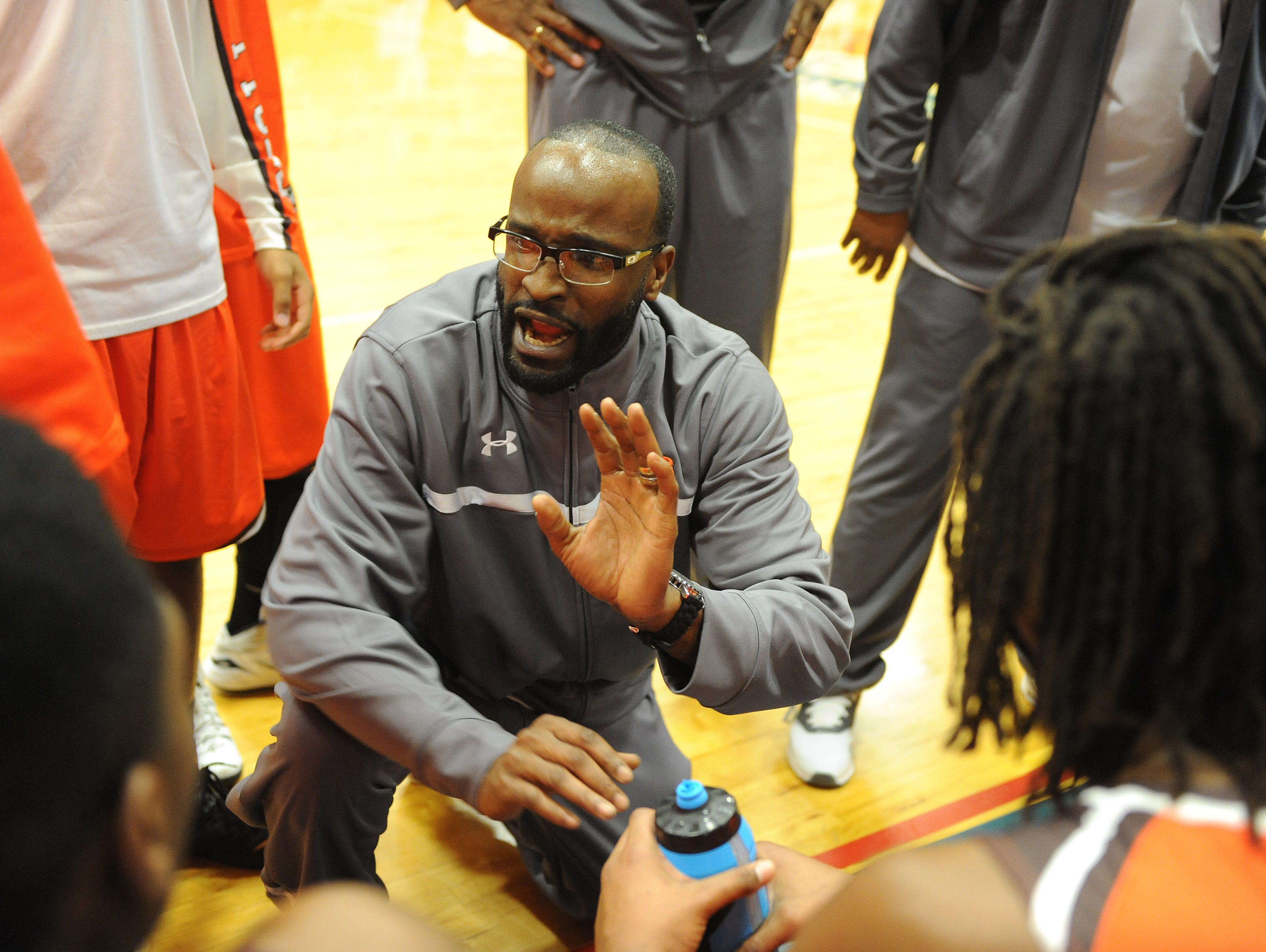 Mansfield Senior boys basketball coach JT Reese talks to his team during a timeout of last year's tournament game with Ashland. The Tygers open with Ontario Friday then travel to Wilington College Saturday at 4:30 p.m. to play Park Tudor, the two-time defending state champs from Indiana.