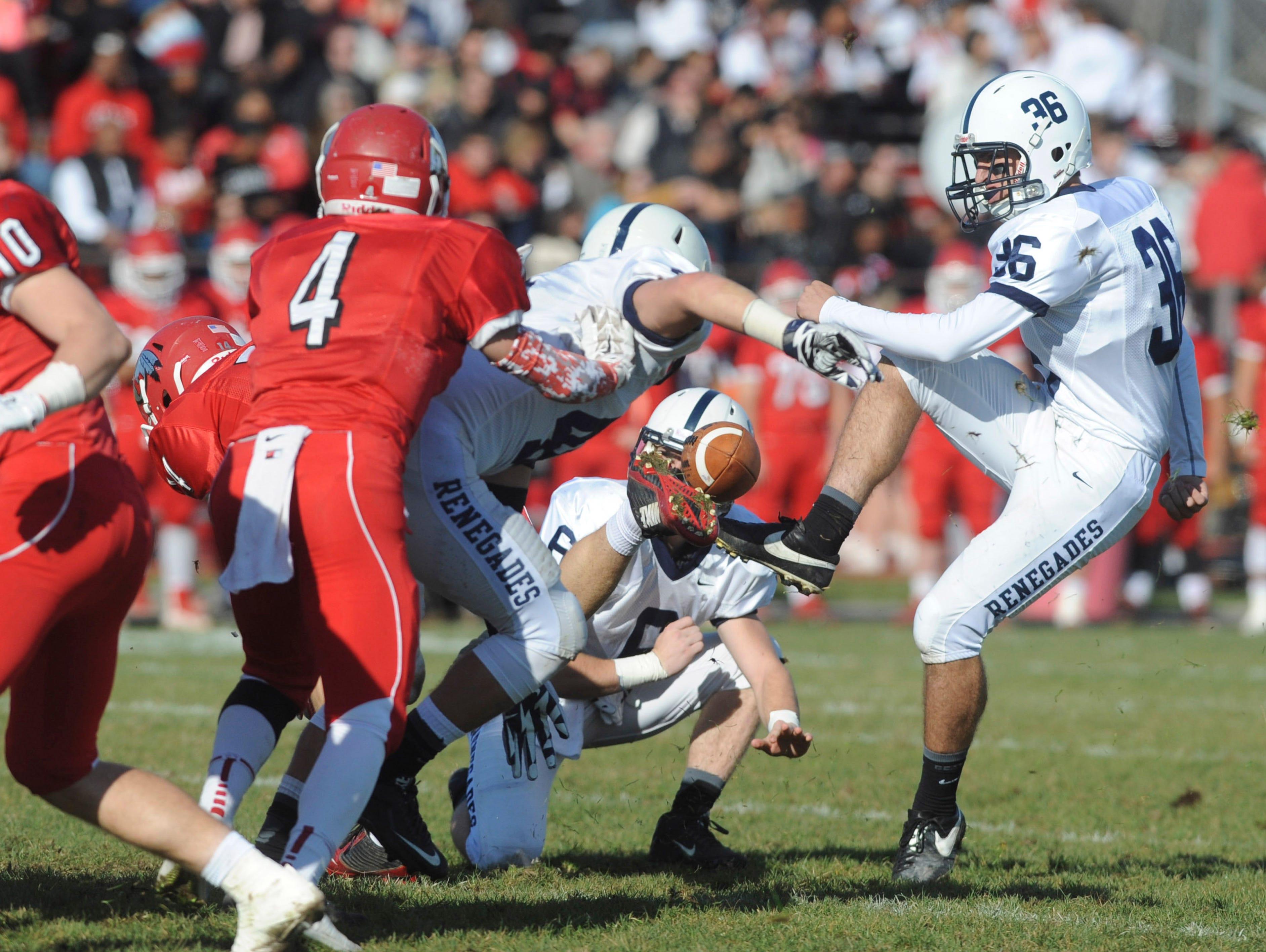 Shawnee kicker RIch Demko has the field goal blocked during Thursday's Thanksgiving Day football game against Lenape. Thursday, November 26, 2015.