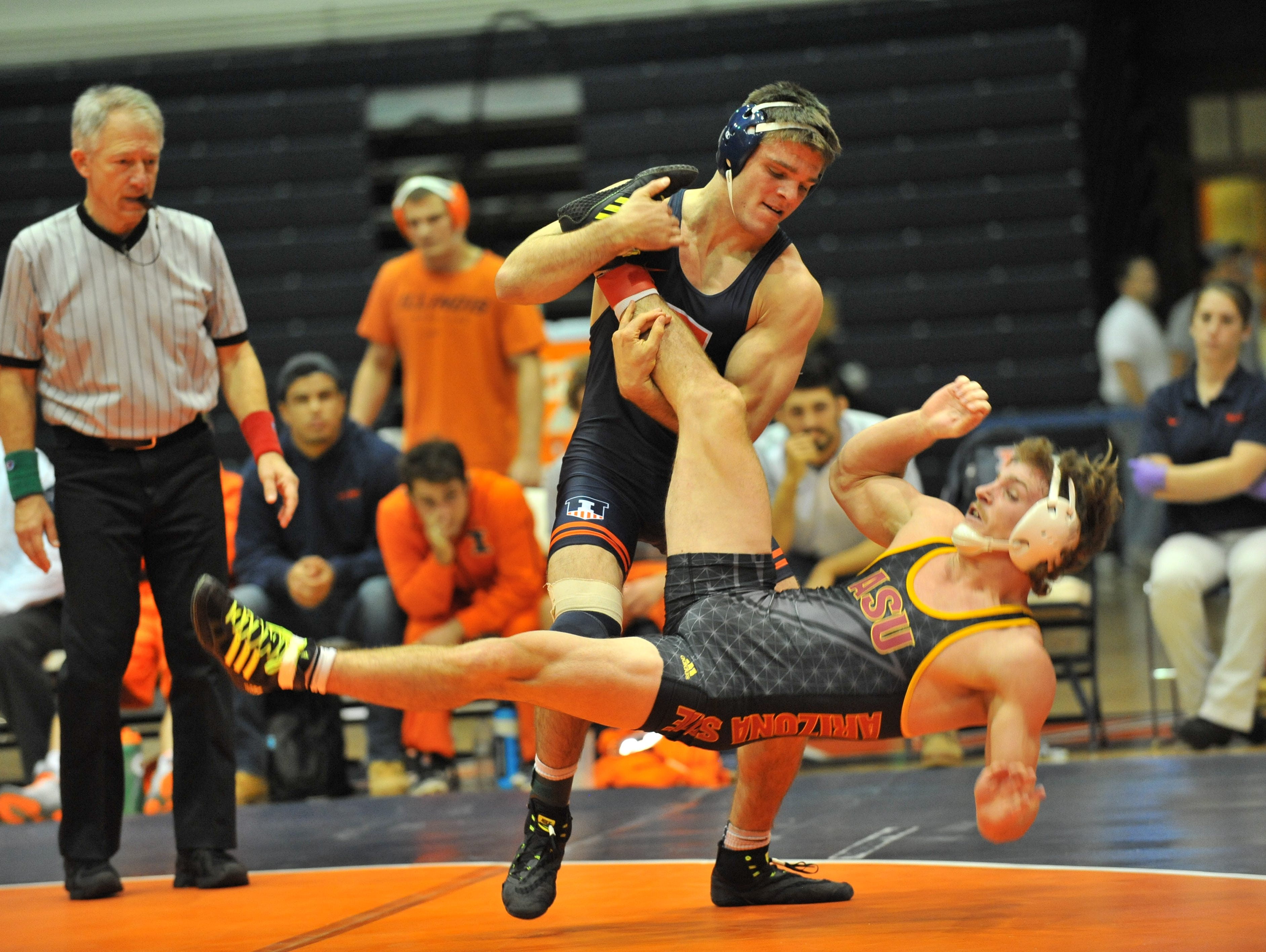 Fox Lane graduate Steven Rodrigues (standing) wrestles for the University of Illinois and competed the fourth annual Grapple at the Garden on Sunday.