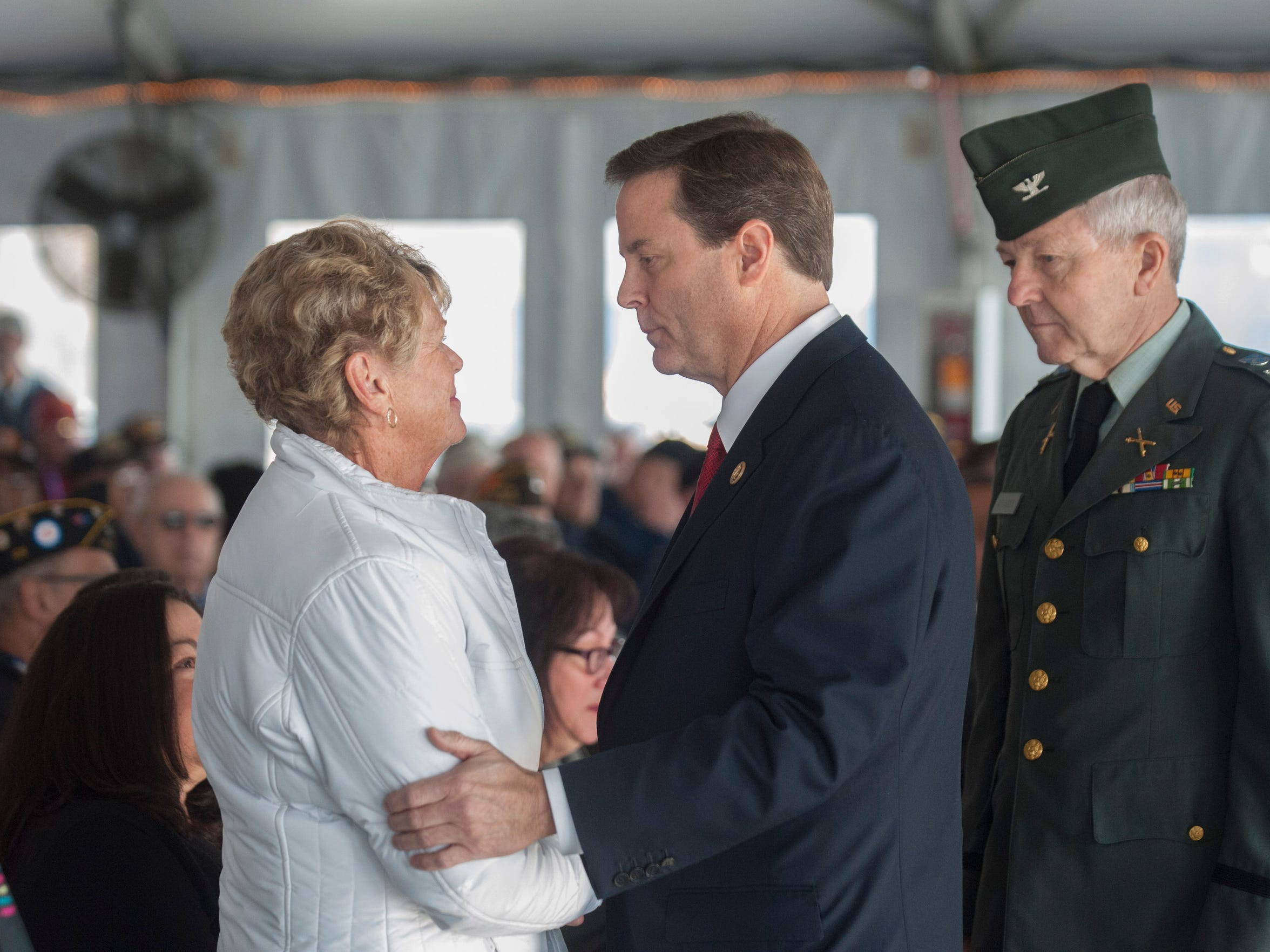 Congressman Donald Norcross speaks with Gold Star Mother Judith Tapper of Atco who lost her son David Tapper in Afganistan in 2003 during the Pearl Harbor Day Commemoration aboard the Battleship New Jersey. Monday, December 7, 2015.