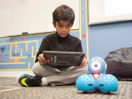 Third-grader Vikram Verma codes the movements and functions of a bluetooth robot during coding class at Moorestown Friends Lower School. Friday, December 11, 2015.