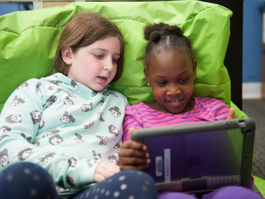 Third-graders Caden Sherin (left) and Chloe Brame-Smalls create code for a personalized game during coding class at Moorestown Friends Lower School. Friday, December 11, 2015.