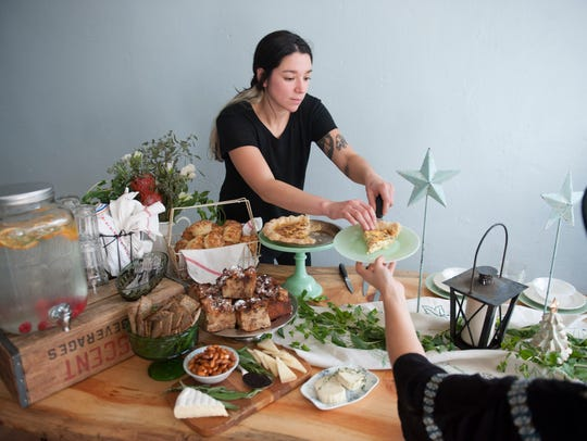Valentina Fortuna works on a table setting at Constellation Collective in Collingswood in 2015.