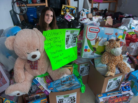 Lauren Levin of Marlton collected over 1,000 toys in a campaign called Holton's Heroes 1st Annual Toy Drive, raising awareness for her nephew Holton Weingrad who suffered severe head injury at the age of 11 weeks old. The donated toys will benefit the Snowflake Foundation at Children's Hospital of Philadelphia. Thursday, December 17, 2015.