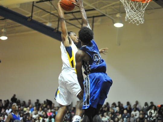 Pocomoke's LeAnder Roberts going for a dunk against Decatur.
