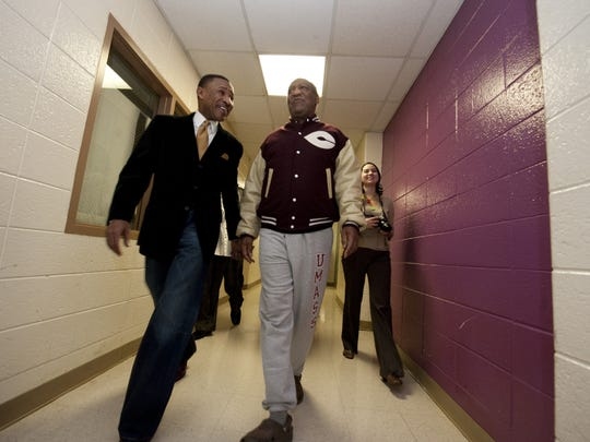Bill Cosby and Pastor Derrick Johnson walk out to address kids ages 16-23 at the West End Neighborhood House in Wilmington in 2009.