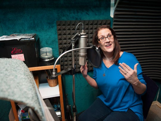 Cherry Hill resident and voice over actress Eve Elliott records a commercial in her home studio. Wednesday, January 6, 2016.