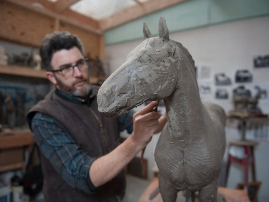 Sculptor Joshua Koffman of Philadelphia works on a 30 inch model of a Percheron horse that he will use to create the 7 foot sculpture for the new Percheron Park in downtown Moorestown. Thursday, January 14, 2016.