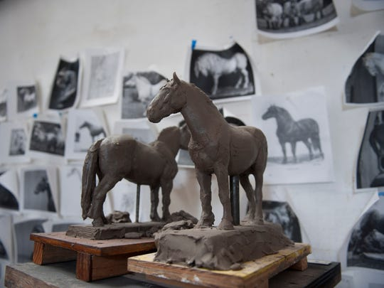 Sculptor Joshua Koffman of Philadelphia created mini clay studies of Percheron horses as he prepares to create the 7 foot sculpture for the new Percheron Park in downtown Moorestown. Thursday, January 14, 2016.