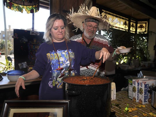Carla Manning and Michael (MADDOG!) Adams prepare chili during a past Great American Chili Cook-off at Seville Square.